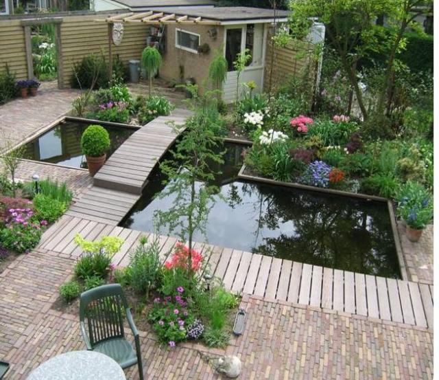 Beautiful garden design with pond with full of green and for Pond garden designs