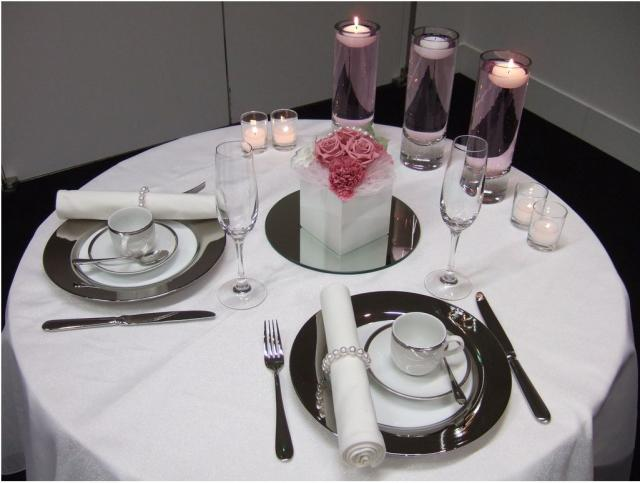 groom and bride table with pink arrangement with lots of candles.JPG