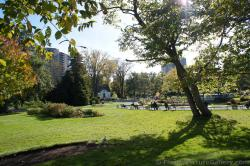 People sitting on benches at Halifax Public Gardens.jpg