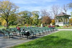 People relax on benches in front of Halifax Public Gardens Gazebo.jpg