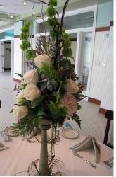 Tall wedding arrangement with silk flowers with cream and pink roses center piece picture.JPG