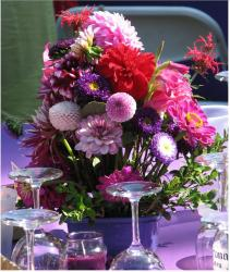 Colorful flower arrangement with pink, red and purple photo.JPG