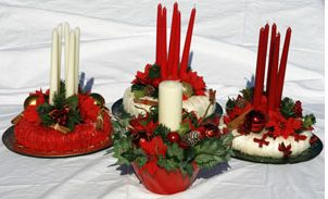 christmas flowers centerpieces with red and white candles.JPG