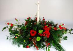 White candle christmas flower arrangements.JPG