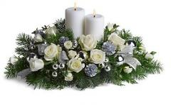 White Christmas flowers centerpice with big fat white candle.JPG