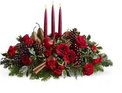 Christmas arrangement with fruits and red candle.JPG