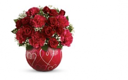 Pic of valentines day flower with red round vase.PNG