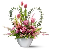 Picture of valentine flowers in pink with heart shape greens.PNG