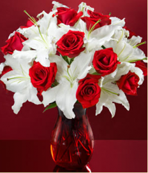White lilies and red roses in red glass vase for valentines day.PNG