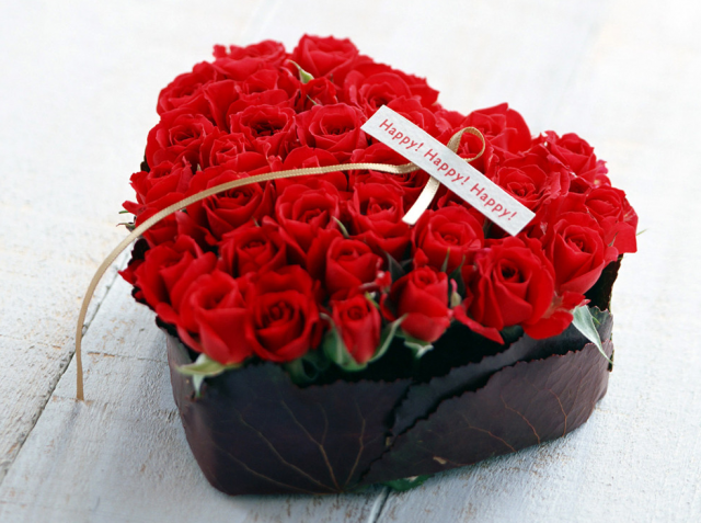 Modern romantic valentine arrangment with full of small red roses picture.PNG