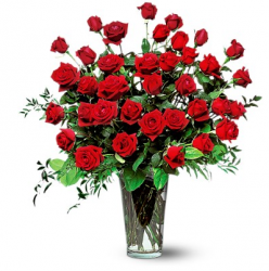 Big valentines day arrangement with red roses in glass vase.PNG