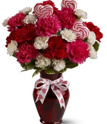 Bright multi color flowers for valentines day with heart shaped candies.PNG