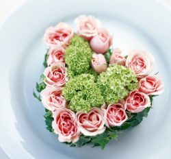 Gorgeous valentine arrangement with green flowers and pink roses and green frame.PNG