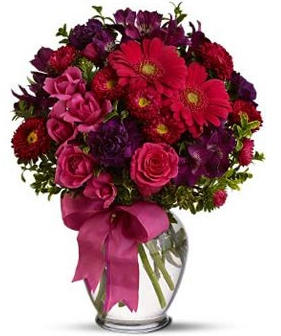 Modern bouquet for valentines day with rich colored flowers.PNG
