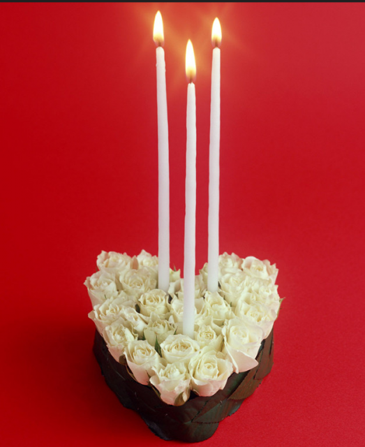 Modern valentines day with white fresh rose and white long candles.PNG