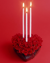 Trendy heart shaped roses valentine arrangement with white long thin candles.PNG