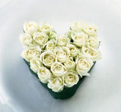 White roses valentine arrangment in heart shape with green frame.PNG
