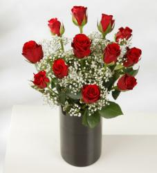 Red roses bouquet with small white flowers in chic black vase.JPG