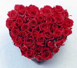 Romantic looking bouquet in heart shape with bright red roses - great Valentines Day gift ideas.JPG