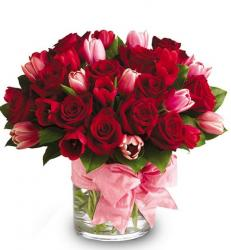 Valentines Day center piece with pink tulips and red roses.JPG