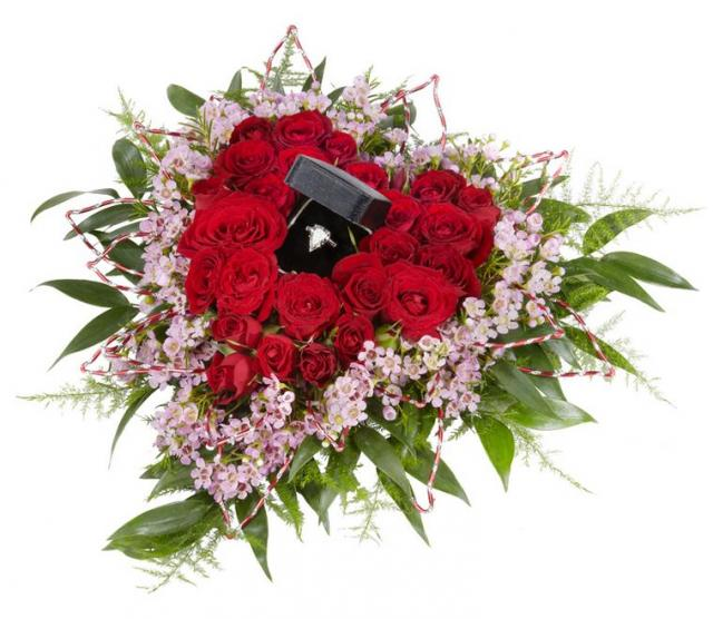Valentines Day special bouquet with red roses and small purple flowers all shaped in heart and with diamond ring.JPG