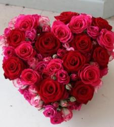Beautiful Valentines day gift with heart shaped bouquet in red roses and pink roses.JPG