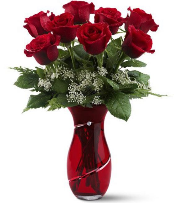 Classic simple valentines day bouquet with red roses with small flowers in red vase.JPG
