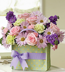 Great mother's day flowers idea with this beautiful blooms in handbag.PNG
