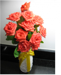 Special gift idea for mother's day with rich orange roses in white vase and yellow ribbons.PNG