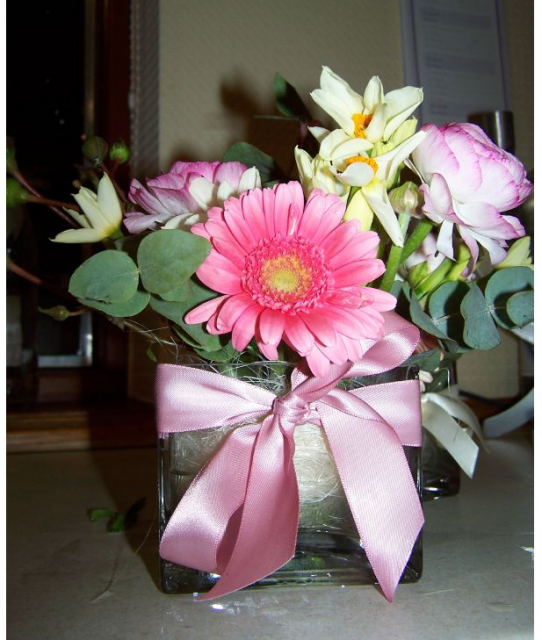 Trendy mother's day flower gift in short square vase with pink ribbons.PNG