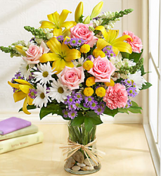 mother's day flower gift with this pretty bright yellow and others flowers in glass vase with stone inside.PNG
