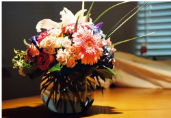 Mother's day flower in round short glass vase.PNG