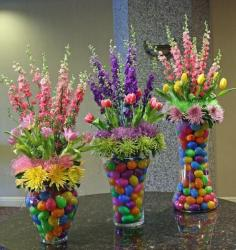Beautiful Easter flower arrangements with colorful plastic eggs.JPG