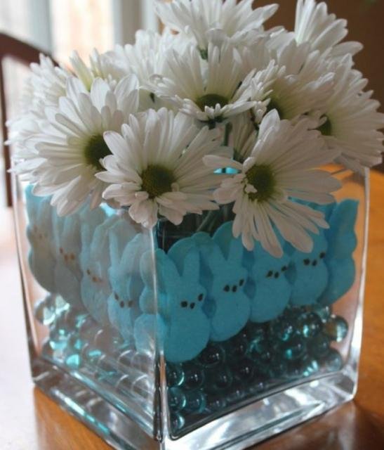 Blue and white Easter flowers centerpiece with white daisies and blue bunny candy.JPG