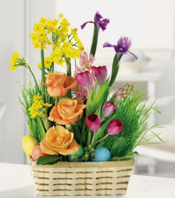 Colorful Easter flowers basket arrangement with Easter eggs.JPG
