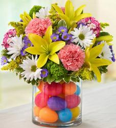 Colorful Easter flowers center piece with bright colored plastic eggs.JPG