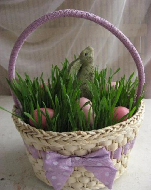 Cute Easter gifts picture of a basket with grass eggs and a bunny standing among the grass and Easter eggs.JPG