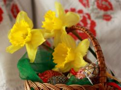 Easter basket with yellow Easter flowers and beautiful Easter eggs with painted patterns.JPG