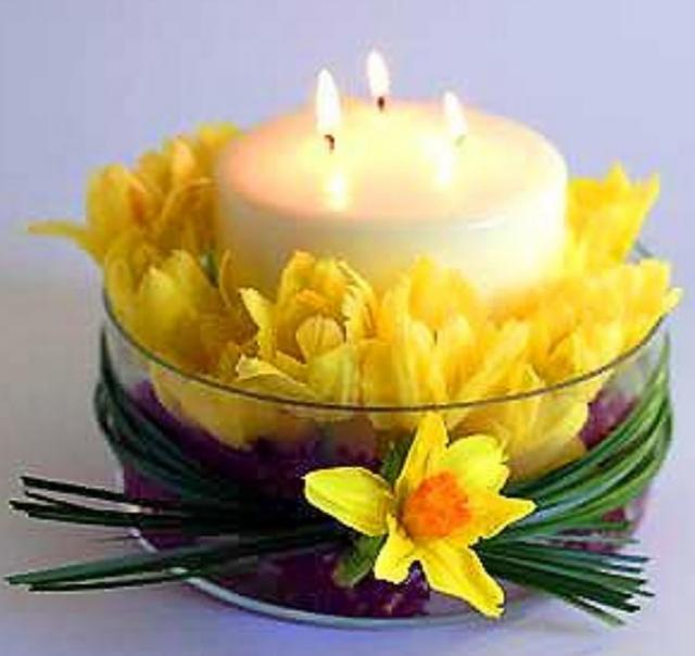 Easter candel centerpiece with Easter flowers.JPG