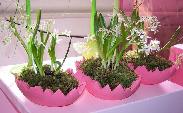 Easter flowers arrangement with white easter flowers and pink egg shaped planters.JPG