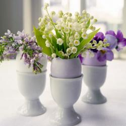 Egg Easter arrangements with white and purple flowers.JPG
