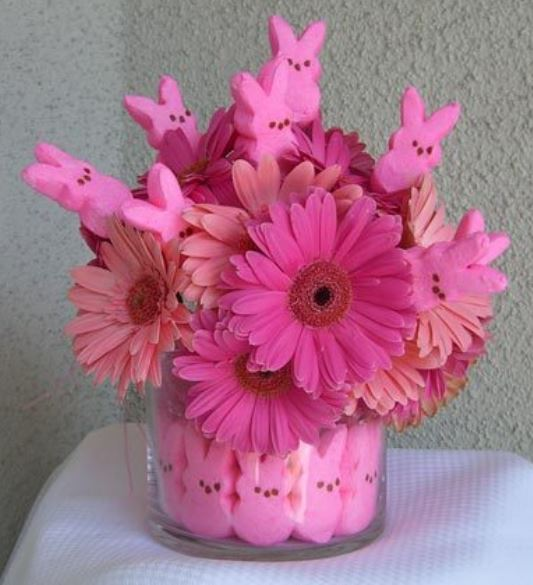 Hot pink Easter center piece with big pink flowers and bright pink candy rabbits.JPG