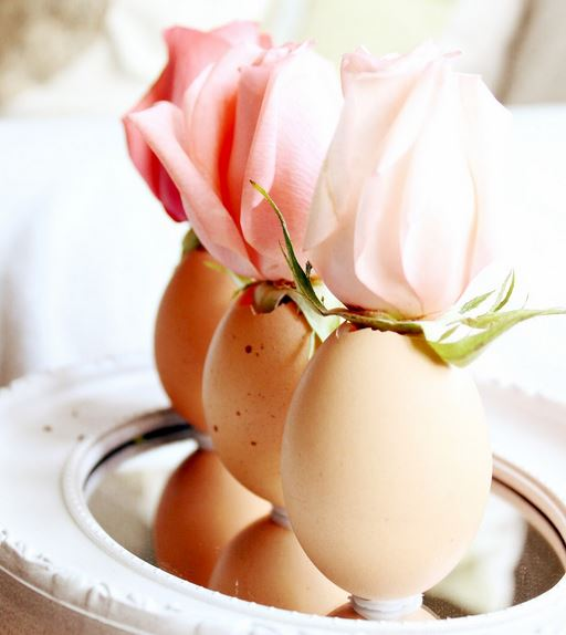 Single pink rose in each egg.JPG