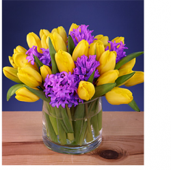 Beautiful refreshing flowers for mothers day with birght yellow tulips and purple flowers.PNG