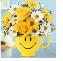 Fun mother's day flowers gift in big bright yellow cup with smiling face.PNG
