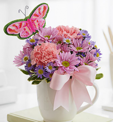 Get mother's day flowers delivered to your mommy with this cute choice of flowers in cup.PNG