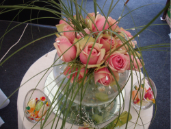 Goldfish bowl wedding arrangement with pink roses.PNG