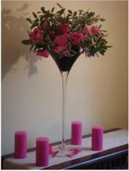 Hot Wedding Flower Arrangement with hot pink candles.PNG