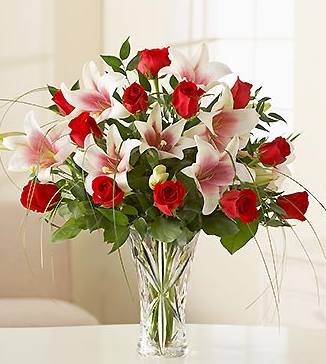 Red rose and white lilies in Lenox Crystal Vase.PNG