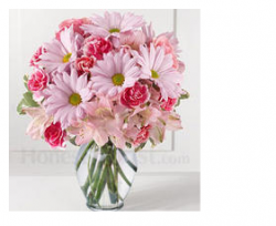 Light and dark pink mother's day flowers in glass vase.PNG